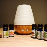 Essential oil bottles and a lamp