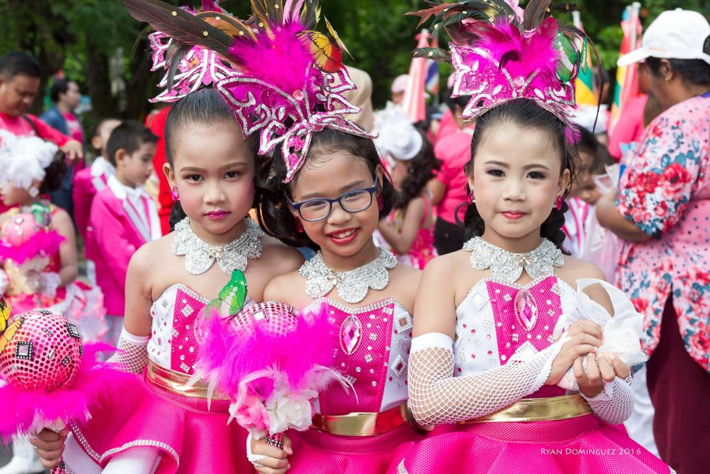 paraders in pink costume - some fun ways to wear wigs