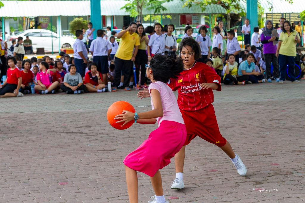 Two girls playing chairball